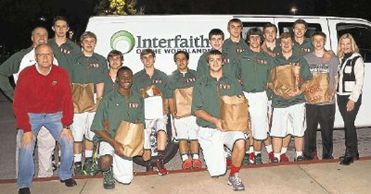 Members of The Woodlands High School varsity basketball team collected 1,060 pounds of food for Interfaith of The Woodlands food pantry. Pictured with The Woodlands High School varsity basketball team are Dr. Gregg Colschen, The Woodlands High School Principal, Coach Dale Reed (far left) and Dr. Ann Snyder, president and CEO of Interfaith of The Woodlands (far right).