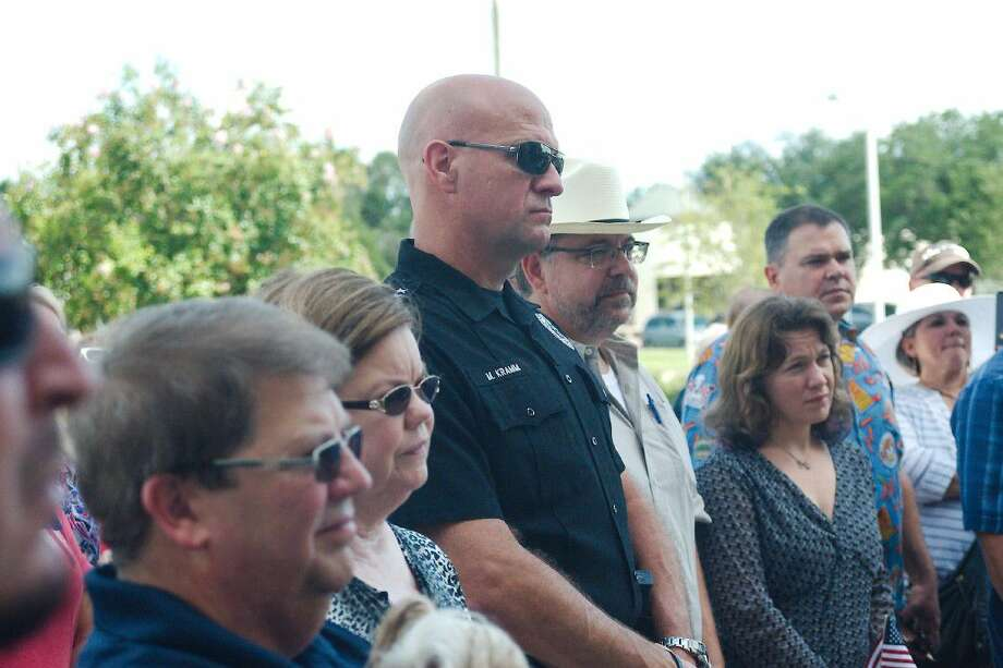 League City Police Chief Michael Kramm listens during Pray for the Blue, a prayer meeting at the League City Police Department headquarters to support officers and first responders Saturday, July 30. Photo: Kirk Sides