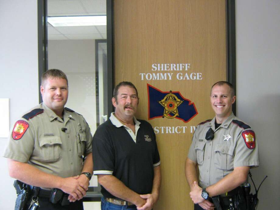 Two Montgomery County Sheriff's Office deputies were reunited with a man whose live they saved in March after responding to a welfare check call. Pictured from left are Deputy J. Erikson, William Wright of Magnolia and Deputy S. St. John.