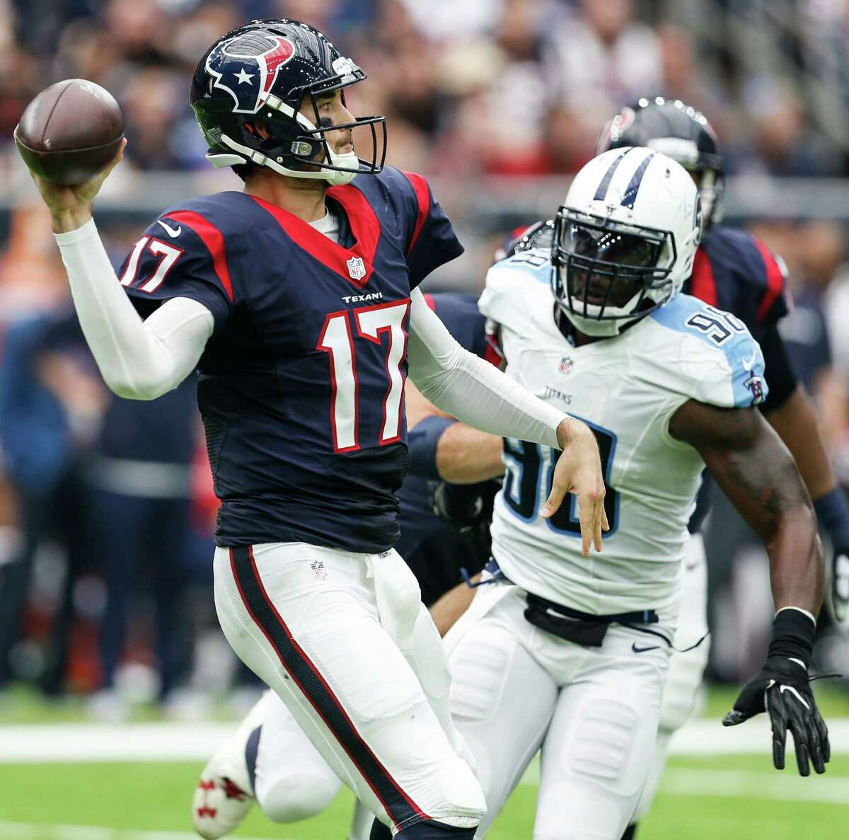 Houston Texans quarterback Brock Osweiler (17) is throws a pass as Tennessee Titans outside linebacker Brian Orakpo (98) puts on defensive pressure during the second quarter of an NFL football game at NRG Stadium on Sunday, Oct. 2, 2016, in Houston. ( Brett Coomer / Houston Chronicle )
