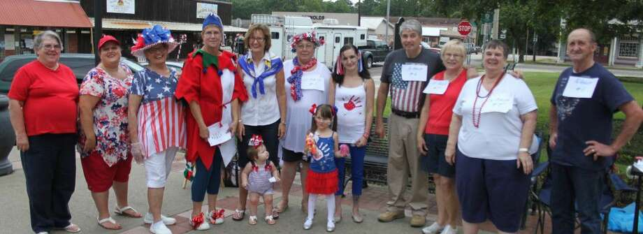 Contestants in the patriotic costume contest gather together for visitors to vote for during the Summer Social at the Coldspring courthouse square on July 28. Photo: Jacob McAdams