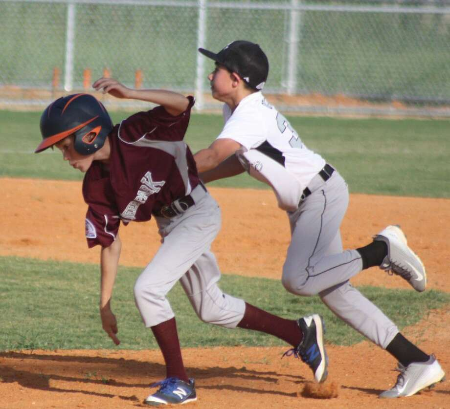 Lucas Lavender, shown getting tagged out in action earlier this summer, saw his bid at playing baseball in California come to an end this weekend. The team went 1-2 at the South Zone Tournament. They defeated a team from Florida, but two fellow Texas teams proved superior. Photo: Robert Avery