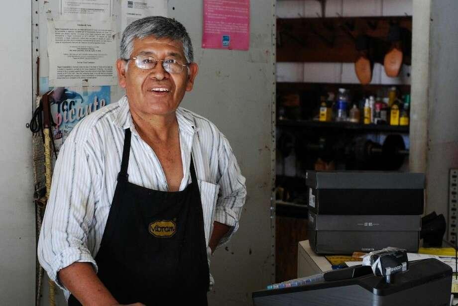 "Amador Gutierrez, owner of Dayton Shoe & Boot Repair, worked on Labor Day. ""No work, no money,"" he says. Photo: CASEY STINNETT"