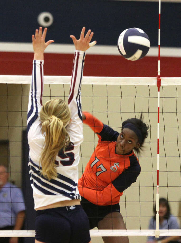 Seven Lakes' Beryl Edem spikes against Tompkins' Hannah Roalson during a volleyball game at Tompkins High School in Katy, Texas on Tuesday, October 7, 2014. To view or purchase this photo and others like it, go to HCNPics.com. Photo: Staff Photo By Alan Warren