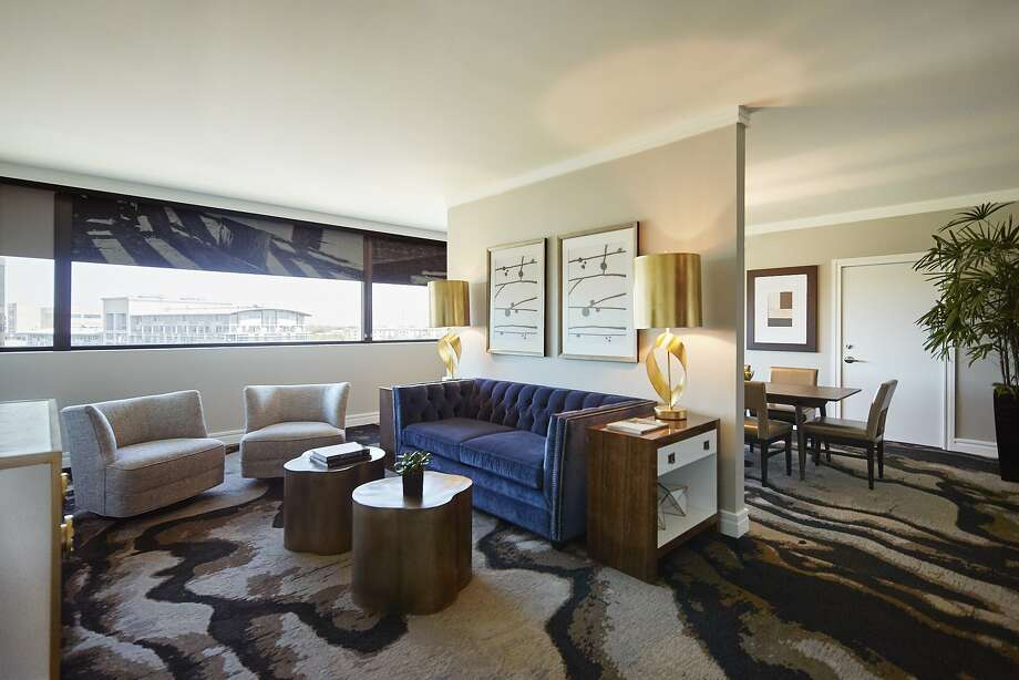 The modern redesign of the Highland Dallas includes shades that serve as functional artwork, burl wood furnishings and nods to region's cowboy heritage. Photo: The Highland Dallas