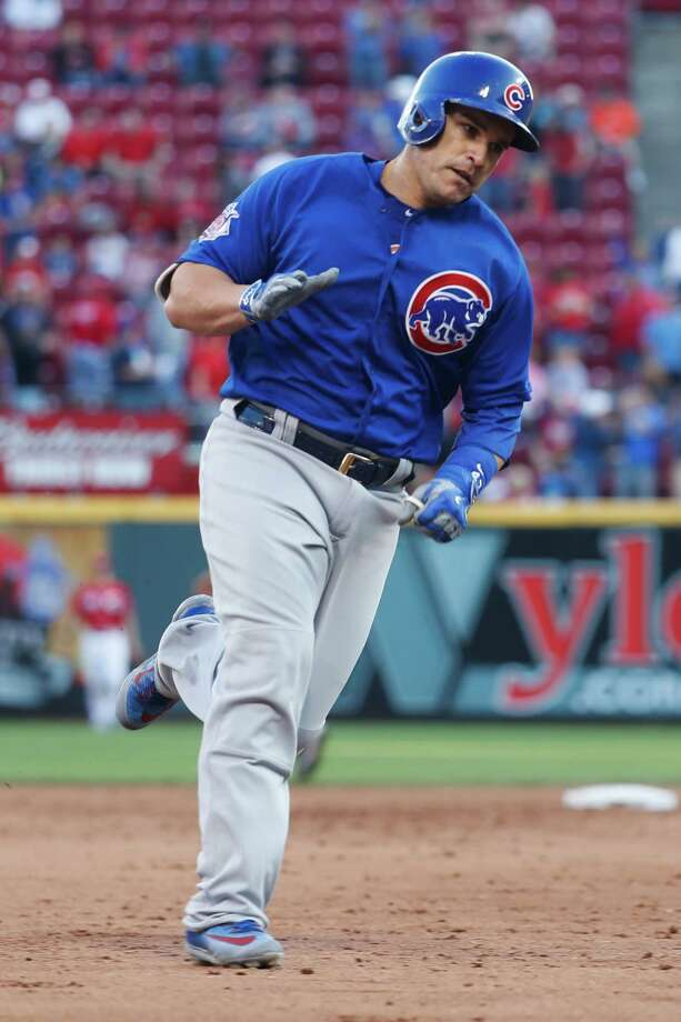 Chicago Cubs' Miguel Montero runs the bases after hitting a two-run home run off Cincinnati Reds relief pitcher Raisel Iglesias in the ninth inning of a baseball game, Sunday, Oct. 2, 2016, in Cincinnati. The Cubs won 7-4. (AP Photo/John Minchillo) Photo: John Minchillo, STF / AP