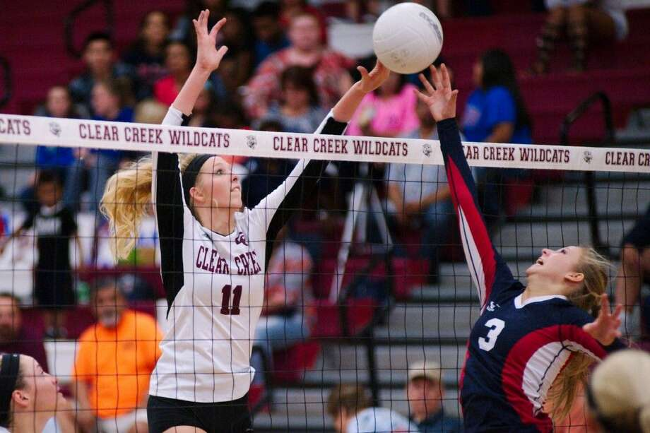 Clear Creek's Melody Horton (11) and Clear Lake's Sam Nidini (3) go hand to hand at the net Tuesday, night. Photo: KIRK SIDES