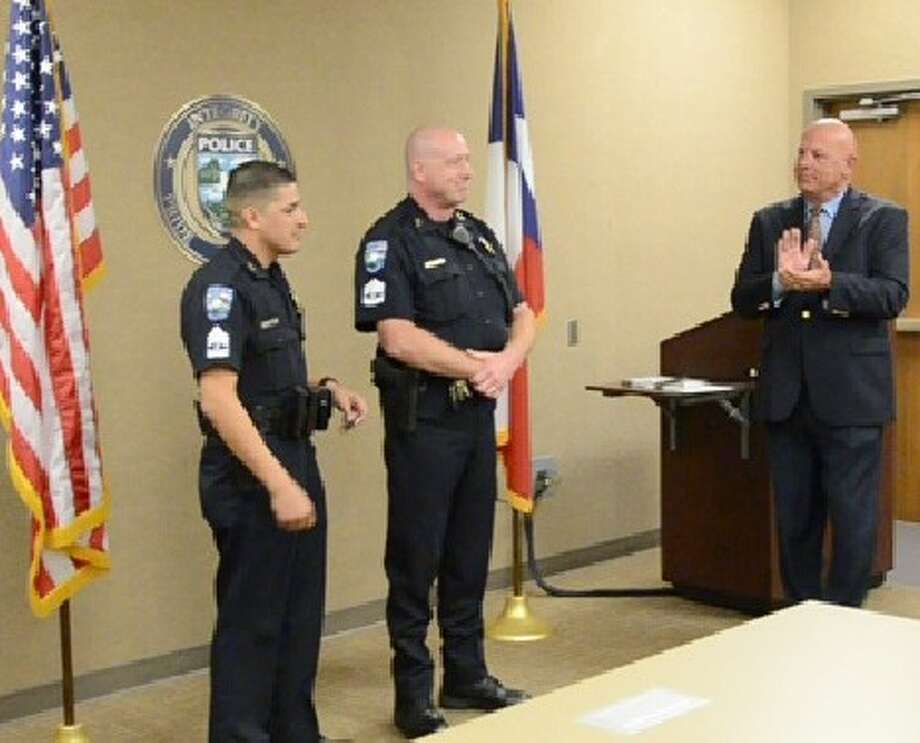 Pearland Police Chief J.C. Doyle (right) congratulates with newly promoted Sgts. Ornaldo Ybarra (left) and David Pratt after they were sworn in at a ceremony held at the Pearland Police Station. Photo: Courtesy Pearland Police Dept.