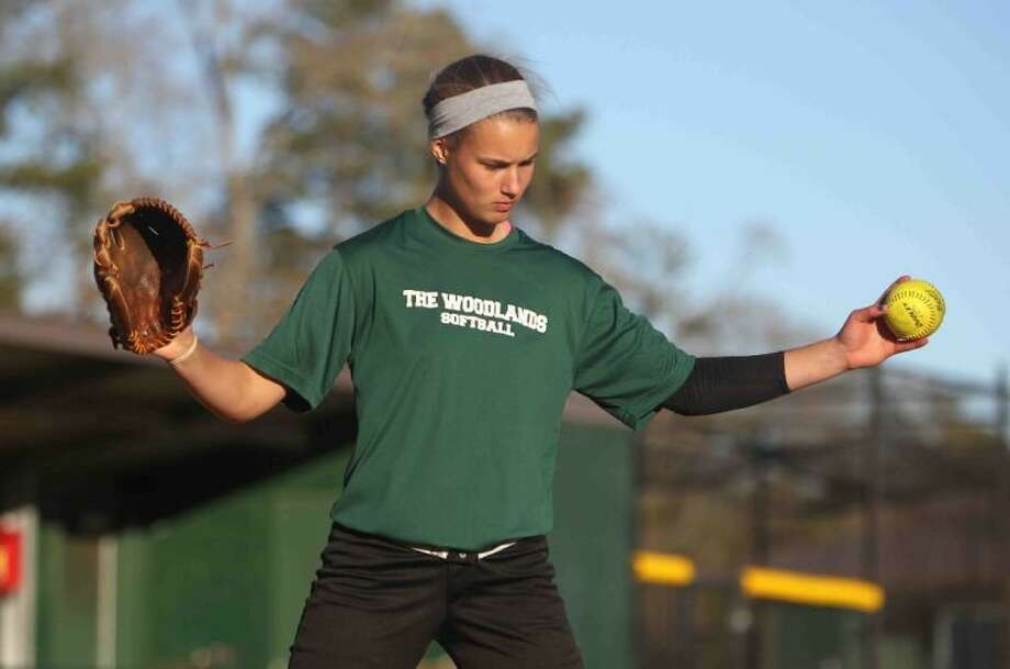 The Woodlands pitcher Abby Langkamp works on her throwing motion during practice last Tuesday. Langkamp is the reigning Player of the Year in Montgomery County. Photo: Staff Photo By Jason Fochtman