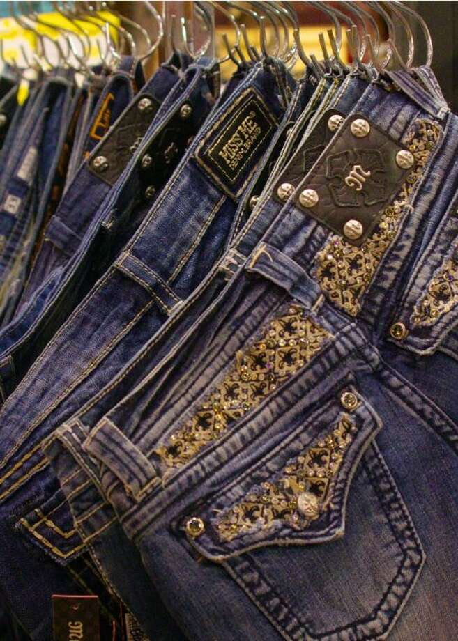 "These Miss Me jeans make a statement at the rodeo with ""bling"" on the pockets and waist. Decorated or ""blinged"" out jeans are one way to show your western style at the rodeo."