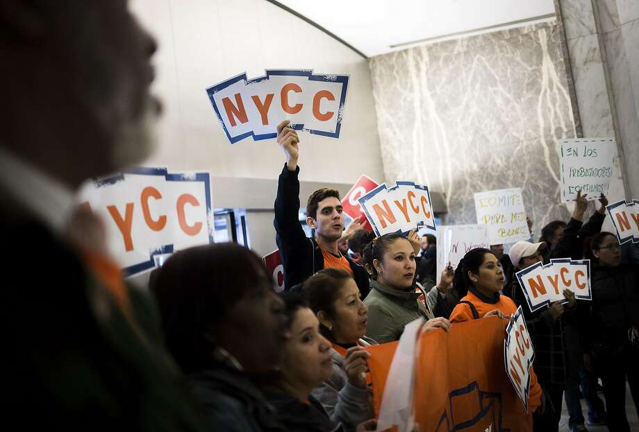 Demonstrators fill a Wells Fargo office in New York. Senators are asking for a criminal investigation. Photo: John Taggart, Bloomberg