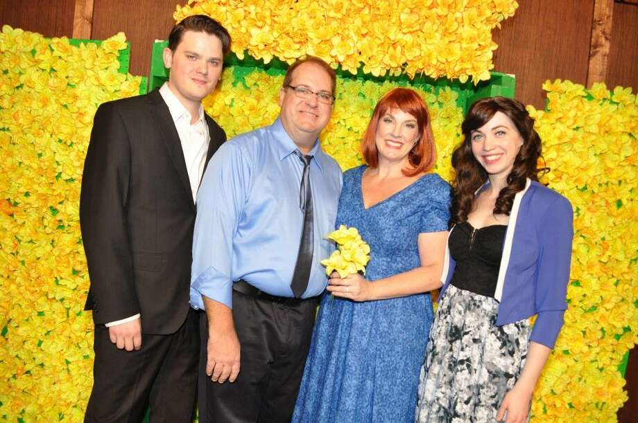 """Starring in the hit musical """"BIG FISH"""" at Art Park Theatre in Deer Park are (l-r) Travis Coombs, Director and son, Will; Lonnie Tanner, Dad, Ed Bloom; Laney Carlin, Mom Sandra and Sarah Konkel, Will's wife, Josephine. The background of daffodils is only a sample of the ingenious sets for the touching production. Call for reservations, 281-797-2448."""