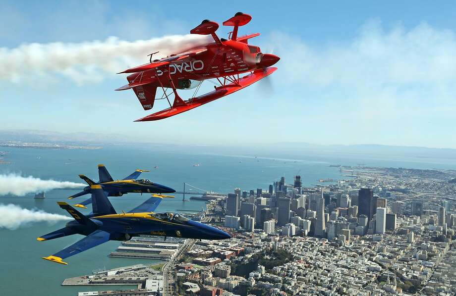Team Oracle's Sean D. Tucker and the US Navy Blue Angels fly over San Francisco , Calif., on Thursday, October 6, 2016. Photo: Scott Strazzante, The Chronicle