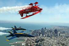 Team Oracle's Sean D. Tucker and the US Navy Blue Angels fly over San Francisco , Calif., on Thursday, October 6, 2016.