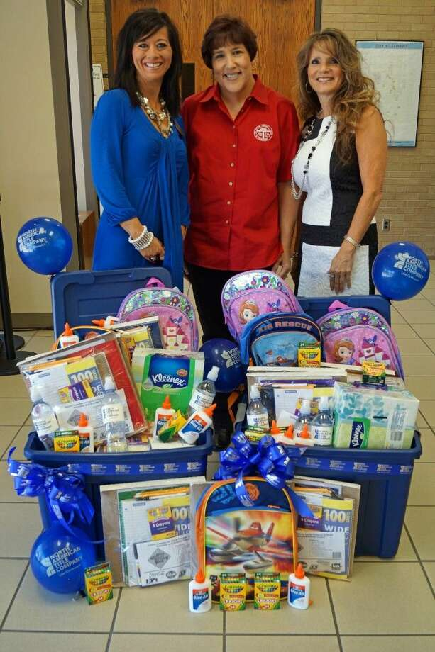 Shown with school supplies donated by North American Title Company (NAT) are, from left, NAT Vice President Cyndi Rifkin, City of Tomball Human Resources Director Lisa Coe, and NAT Business Consultant Vivian Walpole.