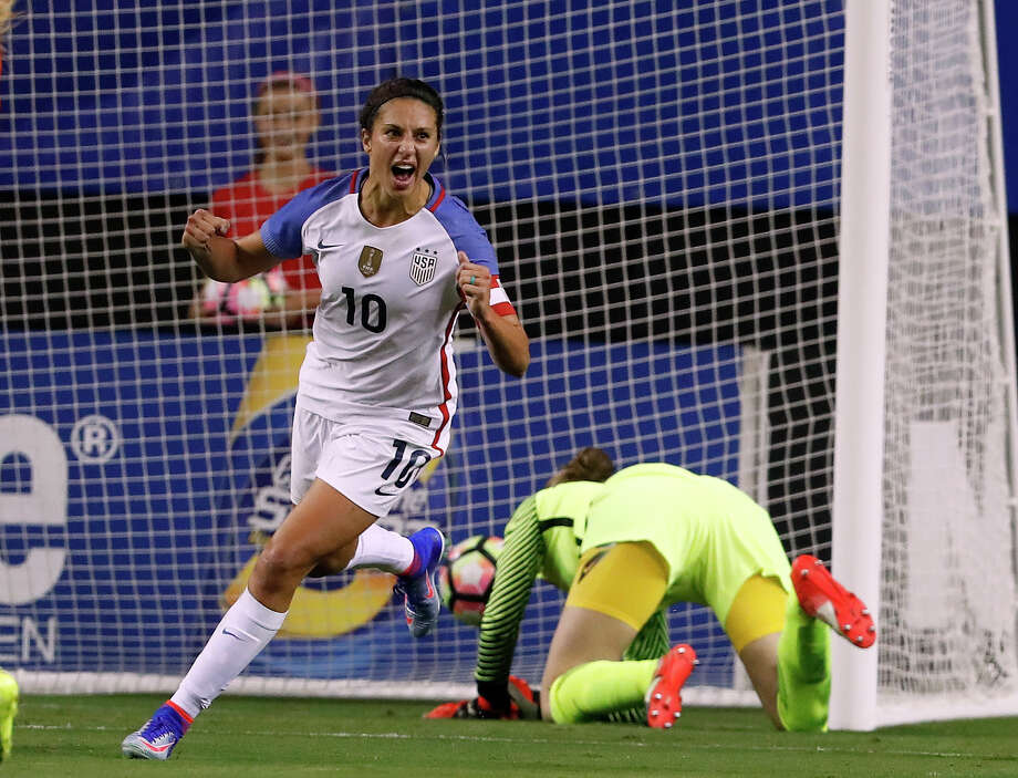 USA's Carli Lloyd (10) celebrates after beating Netherlands goal keeper Sari van Veenendaal for a goal in the first half of an exhibition soccer match, Sunday, Sept. 18, 2016, in Atlanta. (AP Photo/John Bazemore) Photo: John Bazemore, STF / Copyright 2016 The Associated Press. All rights reserved.
