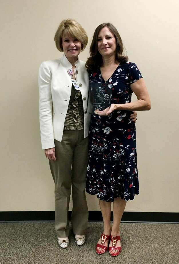 Kingwood Medical Center's CEO, Melinda Stephenson presents Shining Star award to Belle McGinnis, RN, Surgical Oncology Unit.