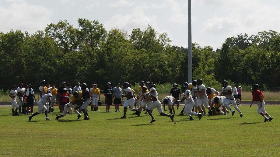 """The defense got the better of this play, scooping up a loose ball and heading for the end zone during the Liberty Panthers' """"Watermelon Scrimmage"""" on Saturday morning, Aug. 6, 2016. The Liberty Panthers will scrimmage against the Buccaneers at East Chambers on Friday, Aug. 12, and then host the Hardin Hornets to a scrimmage on Aug. 19, before the Panthers' regular season gets going with a game at Anahuac on Aug. 26. Photo: Casey Stinnett"""