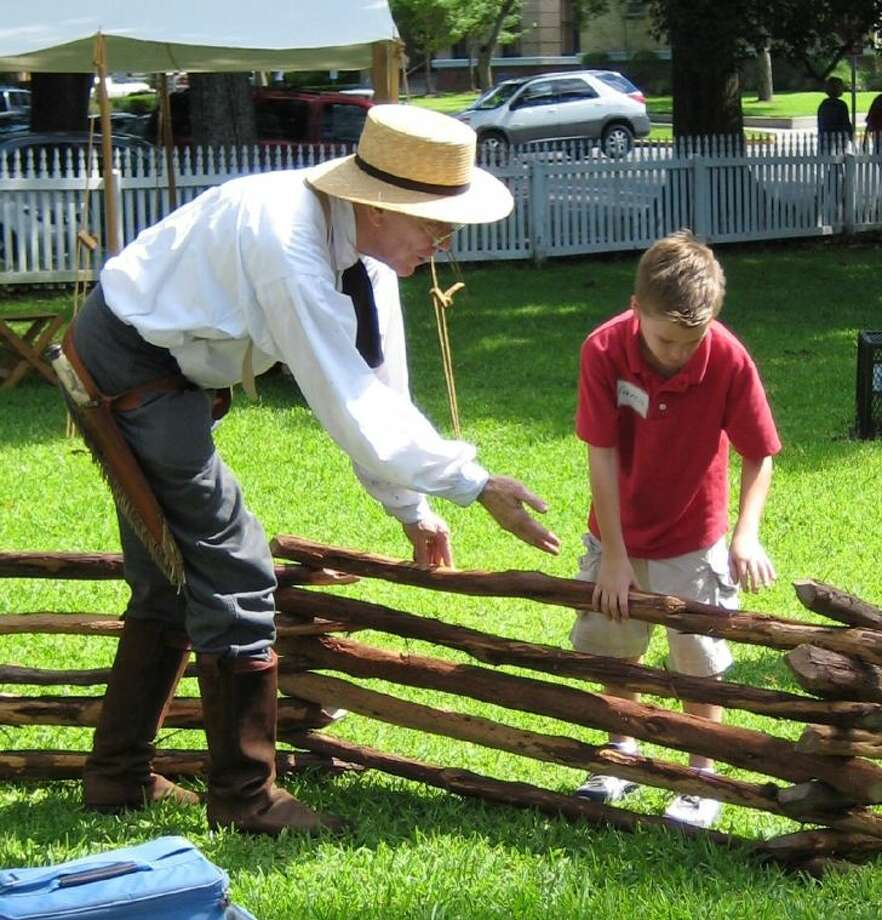 Ed Richards and Francis Smith put the finishing touches on their fence during Summer History Week at the Fort Bend County Museum in Richmond. Photo: Fort Bend County Museum