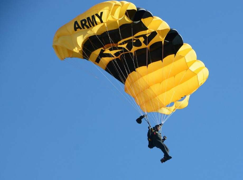 A U.S. Army Golden Knights Parachute Team member descends into the Cypress Woods High School football stadium on Monday to commemorate Veterans Day. Photo: Submitted Photo