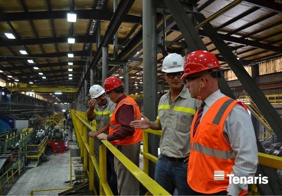 Tenaris Employee Relations Coordinator Robert Guerrero with COCISD Superintendent Jerry Gibson, left, and Plant Manager Alejandro Altamirano with Asst. Superintendent Dr. Byron Terrier tour the Conroe production facility on Tuesday, Oct. 14. Photo: Submitted