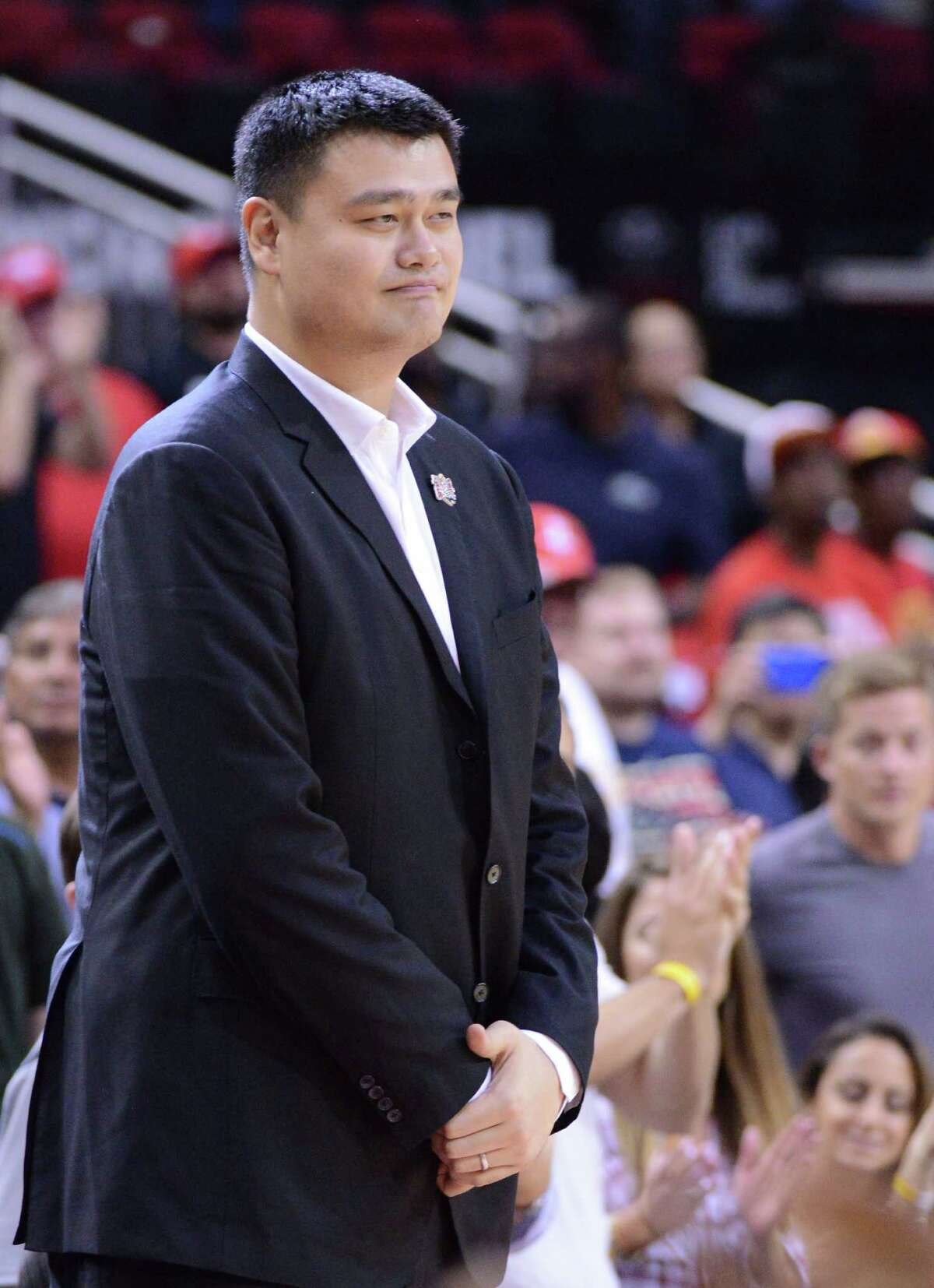 NBA Hall of Fame member Yao Ming is shown as the Houston Rockets face the Shanghai Sharks in an NBA basketball exhibition game Sunday, Oct. 2, 2016, in Houston. (AP Photo/George Bridges)