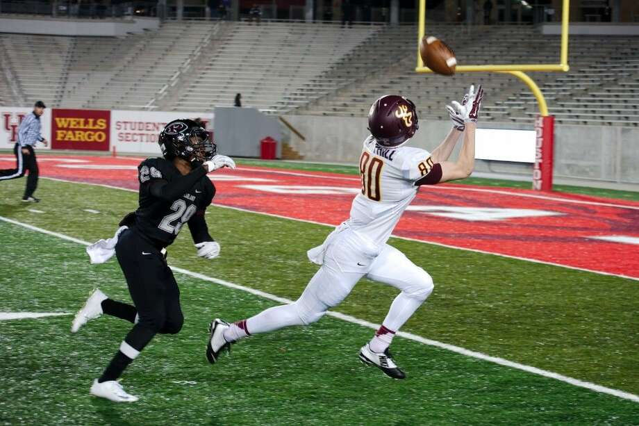 Deer Park's Logan Berryhill (80) makes the catch for a touchdown over Deer Park's Tyler Tuggle (29) Friday, Nov. 12.
