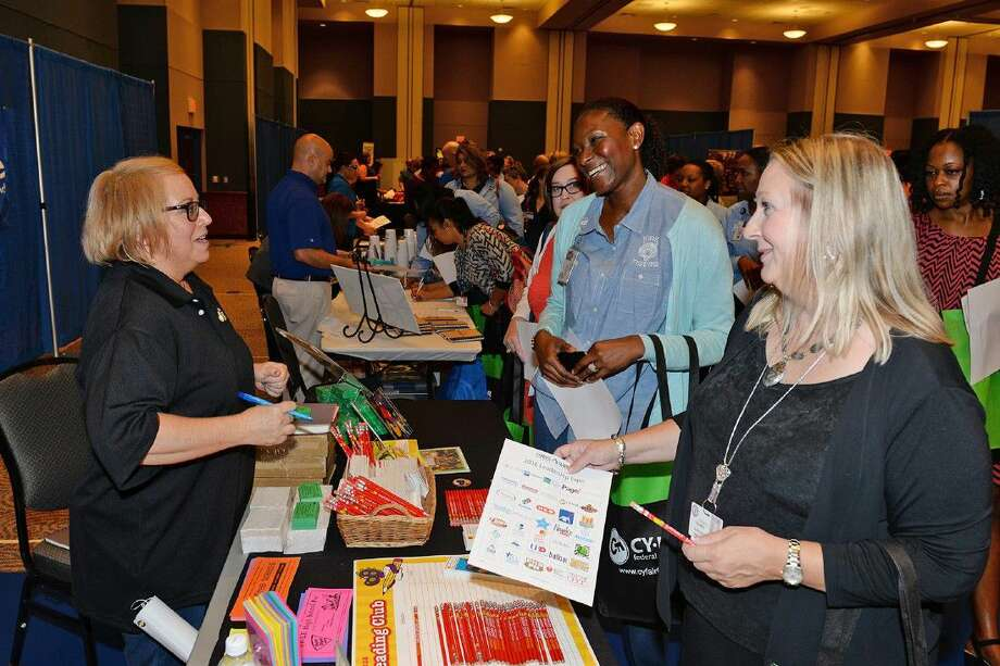 Barbara McKinney, field marketing representative for Peter Piper Pizza, speaks with Kirk Elementary School Principal Onica Mayers and Assistant Principal Susan Blowey during the Business Partner Expo of the Annual Leadership Conference on Aug. 2.