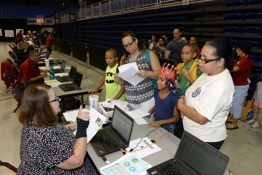 Students enroll for the 2015-2016 school year at the third annual Back-to-School Expo in August 2015. The fourth annual event will be Saturday, Aug. 13 at the Berry Center.