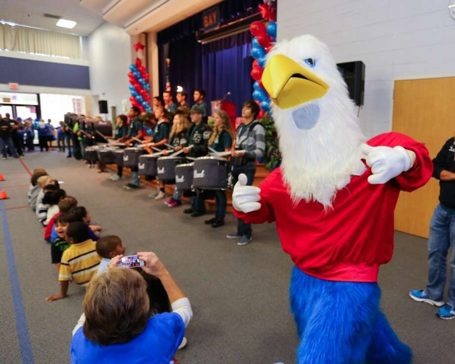 The rain could not dampen the celebration at James F. Bay Elementary as Clear Creek ISD administrators, students, families and community friends gathered to honor the school's 2014 National Blue Ribbon School designation on Friday, November 21, 2014. Photo: Kirk Swann