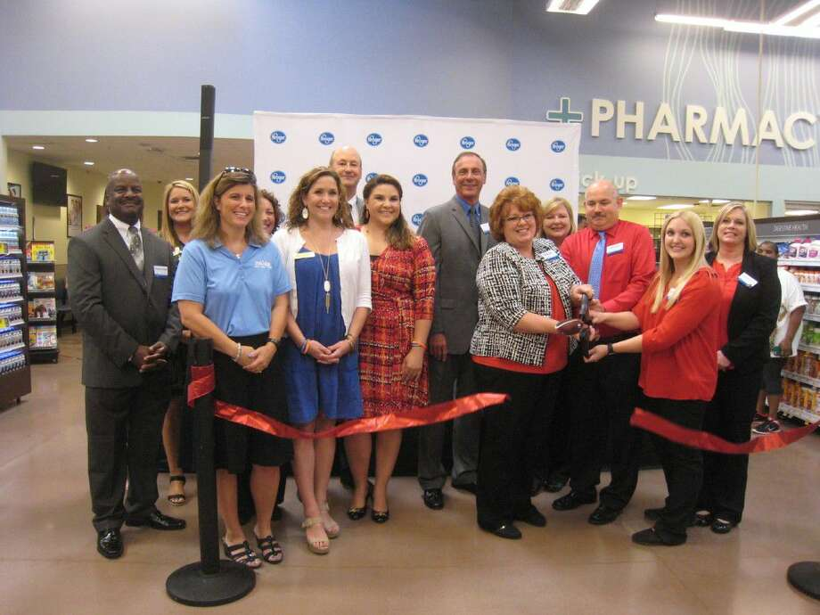 Brenda Mills, Summerwood Kroger Marketplace store manager, cut the ribbon Friday Aug. 5, 2016, celebrating the opening of the new location.