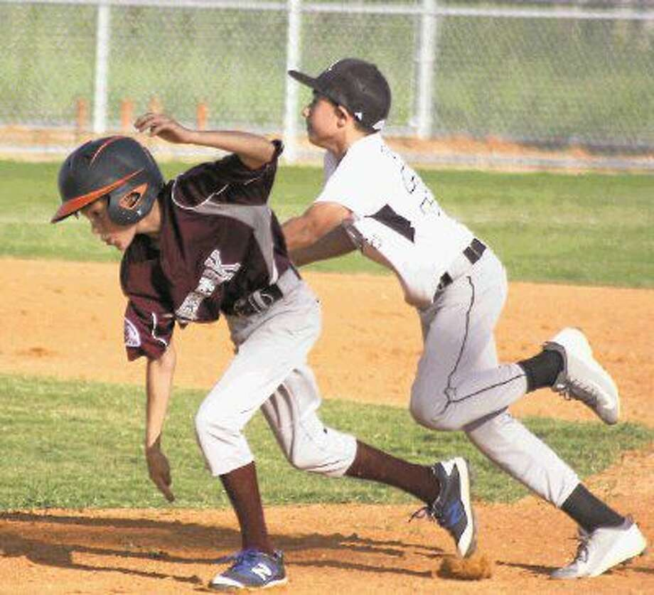 Lucas Lavender becomes an out on the basepaths earlier this summer. Lavender and Deer Park's Bronco Maroon All-Stars saw their season come to an end in Laredo at the South Zone Tournament last Saturday night. Photo: Robert Avery