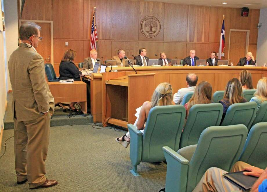 Parke Patterson (pictured at left), owner of the Sugar Land-based firm that proposed the Friendswood Trails development, listens as Councilmember Jim Hill voices his concerns. Photo: Kristi Nix