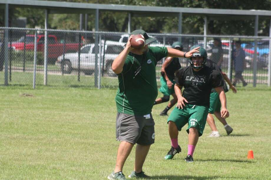 The Pasadena coaches showed their arm strengths during the opening day of fall workouts Monday. Photo: Robert Avery