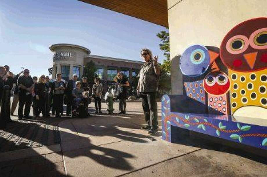 Artist Terrell Powell presents his art bench, Family, during the debut hosted by The Woodlands Waterway Arts Council on Tuesday, Oct. 14, 2014, along the Woodlands Waterway. Photo: Michael Minasi