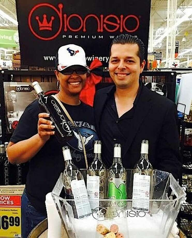 A Pearland resident visits Aranda at the Wine Release Party at the H-E-B store on Business Center Dr.