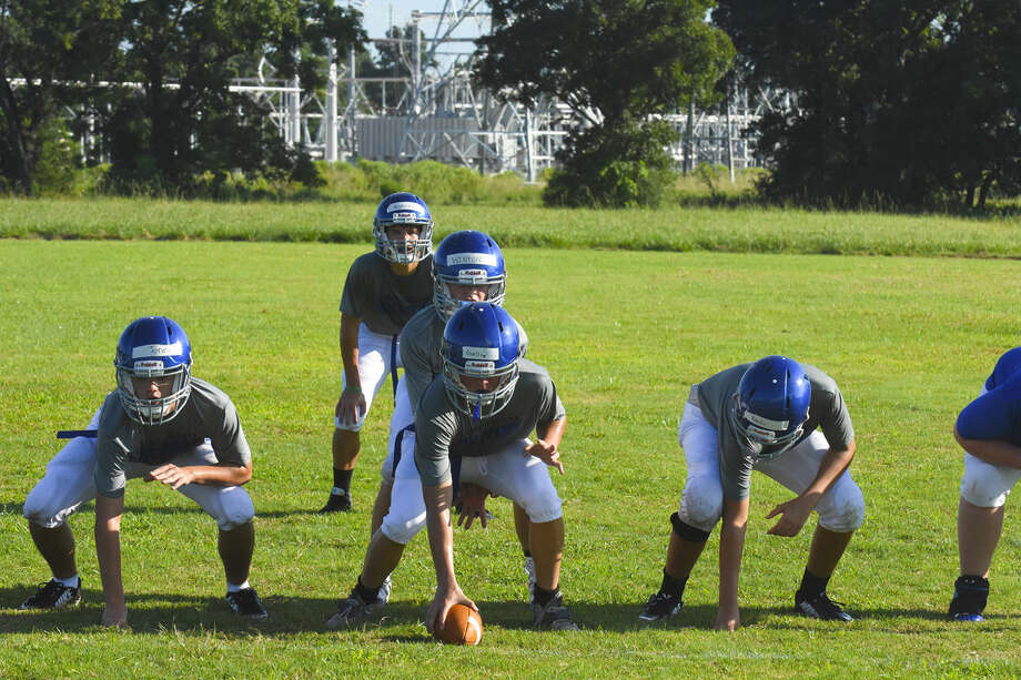 The Frassati Falcons practice for the first time Thursday at Frassati High School. Pictured are freshman quarterback Forrest Winton and sophomore running back J.D. Morgan. Photo: Tony Gaines