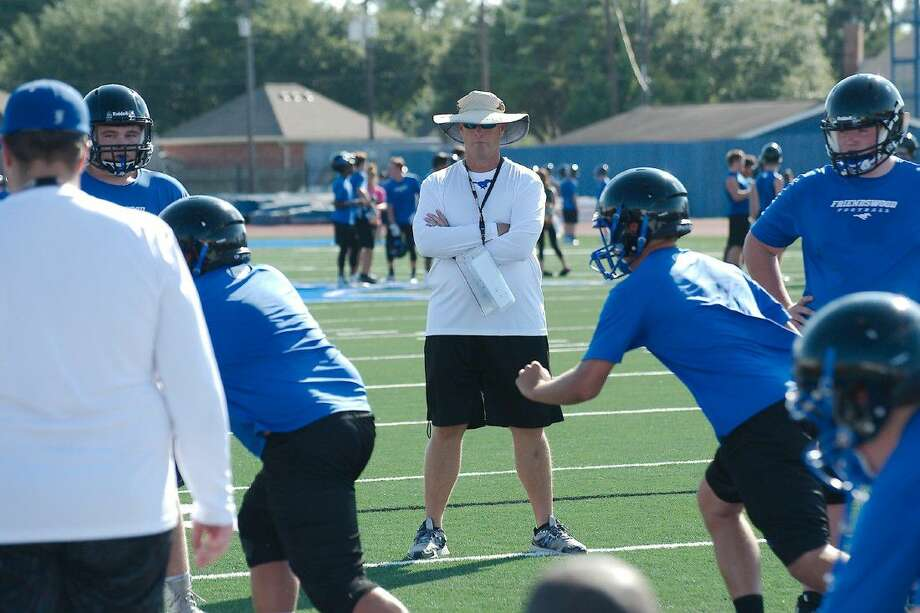 Friendswood football coach Robert Koopmann watches Mustang players go through drills in practice. Photo: Kirk Sides