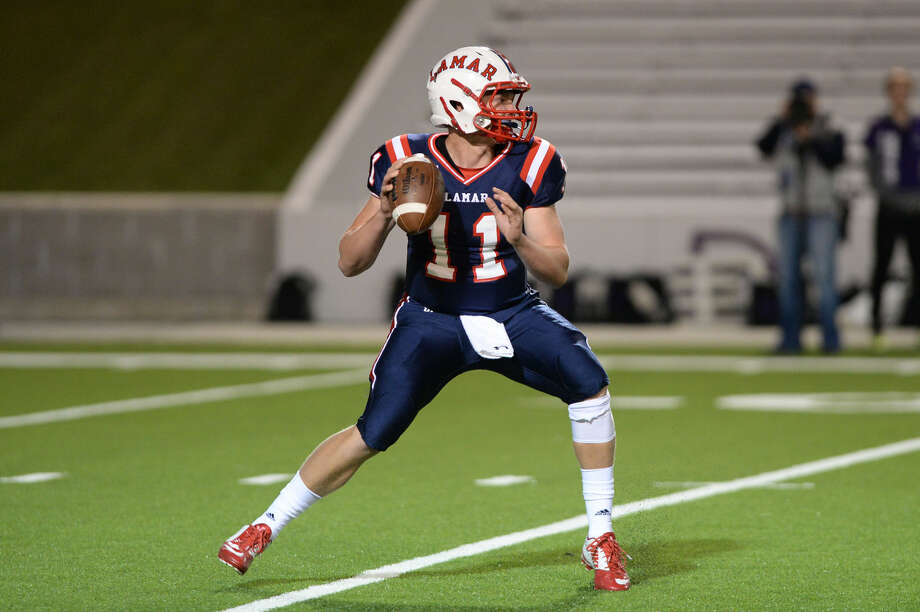 Lamar quarterback Owen Holt looks for receivers against Morton Ranch during their 2015 playoff game at Delmar Stadium in Houston. Holt was selected for the Touchdown Club of Houston's UIL preseason team. To view or purchase this photo and others like it, visit HCNpics.com. Photo: Craig Moseley