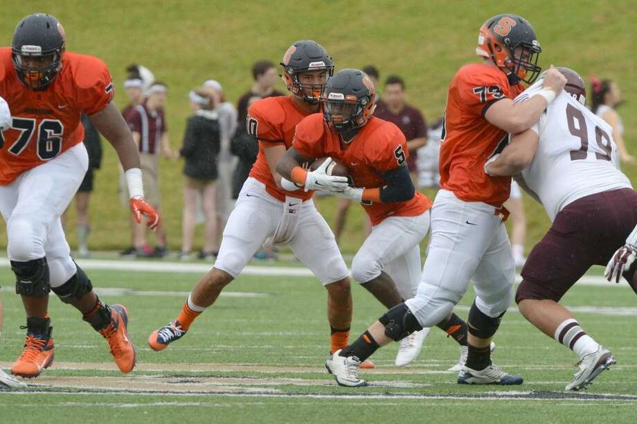 Seven Lakes offensive lineman Kenneth Pleasant (76) leads the Spartans' returning class as they seek a return to the playoffs. Pleasant will represent Seven Lakes on the Touchdown Club of Houston UIL preseason team. Visit HCNPics.com for more photos. Photo: Craig Moseley