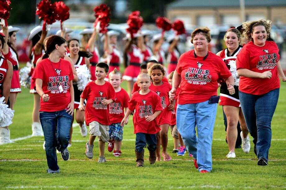Kinder Braves make their inaugural entrance before the Cleveland Indians' game Friday, Sept. 5. The district plans for this to be a regular feature for their home games this season. Photo: Courtesy 59N High School Sports