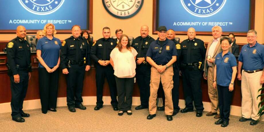 Sugar Land City Council approved the Sugar Land Police Academy Alumni Association's donation of 150 badges on Aug. 2. Picture (L-R) are Police Chief Douglas Brinkley, CPAAA President Wendy Griffith, Lt. Chris Thompson, Officer Adam Cempa, public safety Dispatcher and badge designer Ericka Stroud, Officer Eric Babnew, CPAAA Board Member Richard Fenton, Lt. Wayne Coleman, Capt. Stuart Denton, Assistant City Manager Steve Griffith, CPAAA Board Member Louise Cirasole and CPAAA Vice President Dave Sullivan. Photo: Submitted Photo