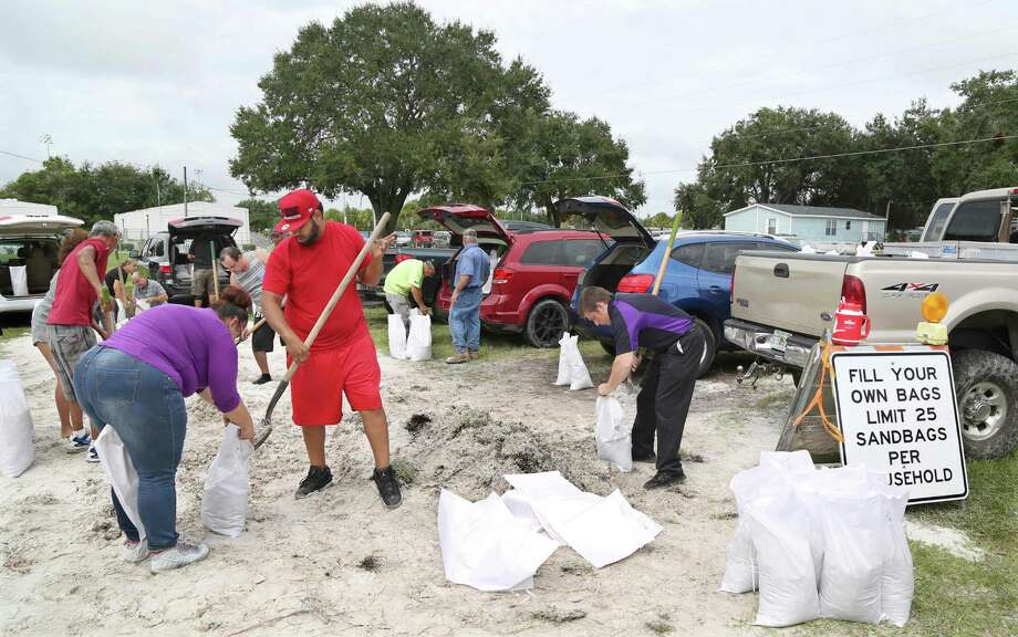 Locals scramble to fill sandbags with the last of a supply at the Road and Bridge Department in Kissimmee, Florida in preparation for the landfall of Hurricane Matthew, on October 6, 2016. Some three million people on the US southeast coast faced an urgent evacuation order Thursday as monstrous Hurricane Matthew -- now blamed for more than 100 deaths in Haiti alone -- bore down for a direct hit on Florida. Photo: GREGG NEWTON /AFP /Getty Images / AFP