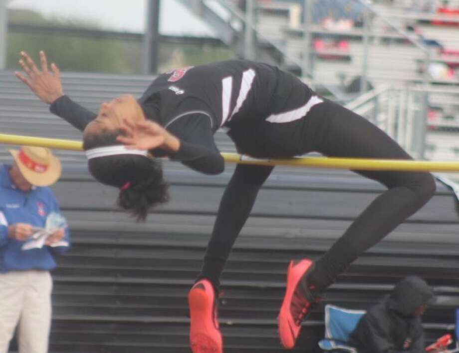 South Houston's Chelsie Decoud bids to clear the high jump bar during competition with the 21-5A qualifiers at the Area meet Wednesday afternoon. Photo: Robert Avery