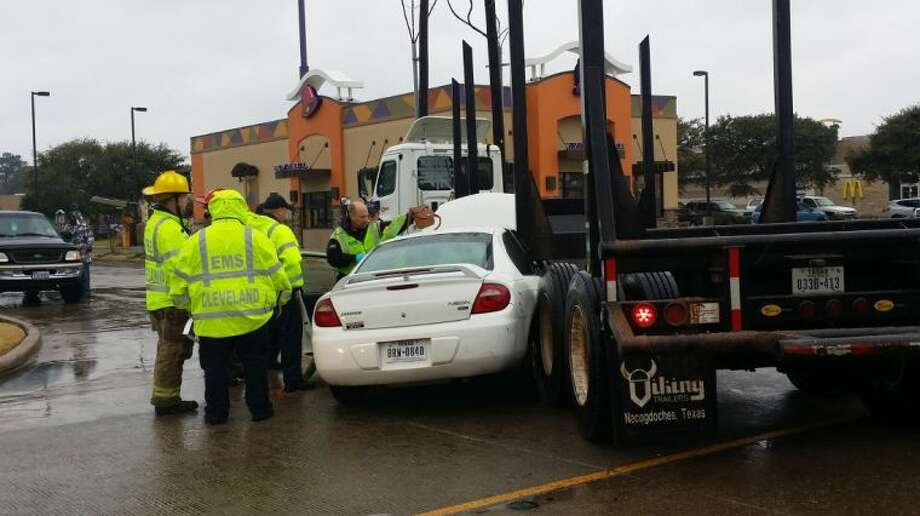 Cleveland firefighters prepare to remove a second person from a Dodge Neon that was involved in an accident with an 18-wheeler shortly before 2 p.m. Thursday, Jan. 23. Photo: VANESA BRASHIER