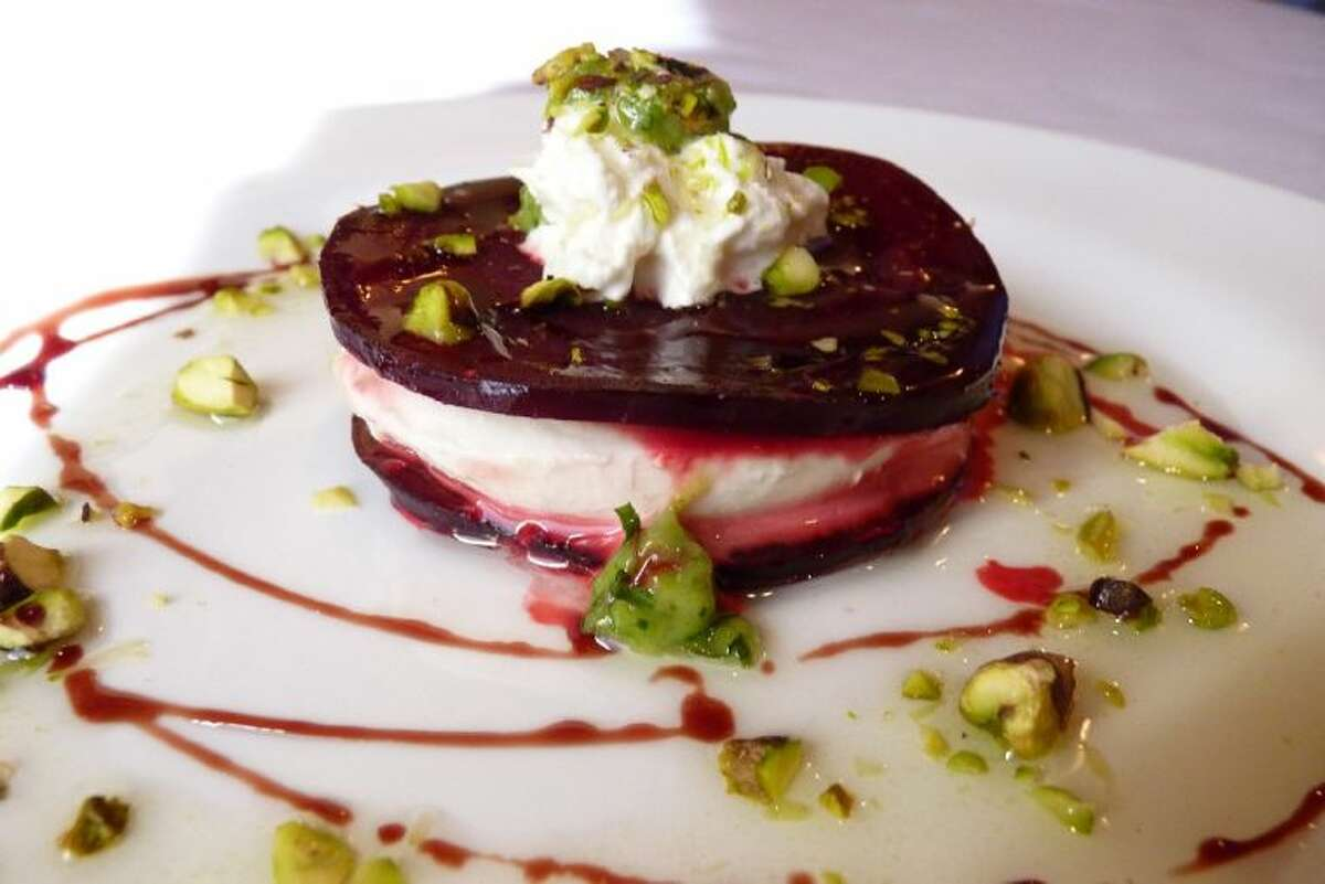Burrata Cheese and Beet Caprese with toasted pistachio and mint vin.