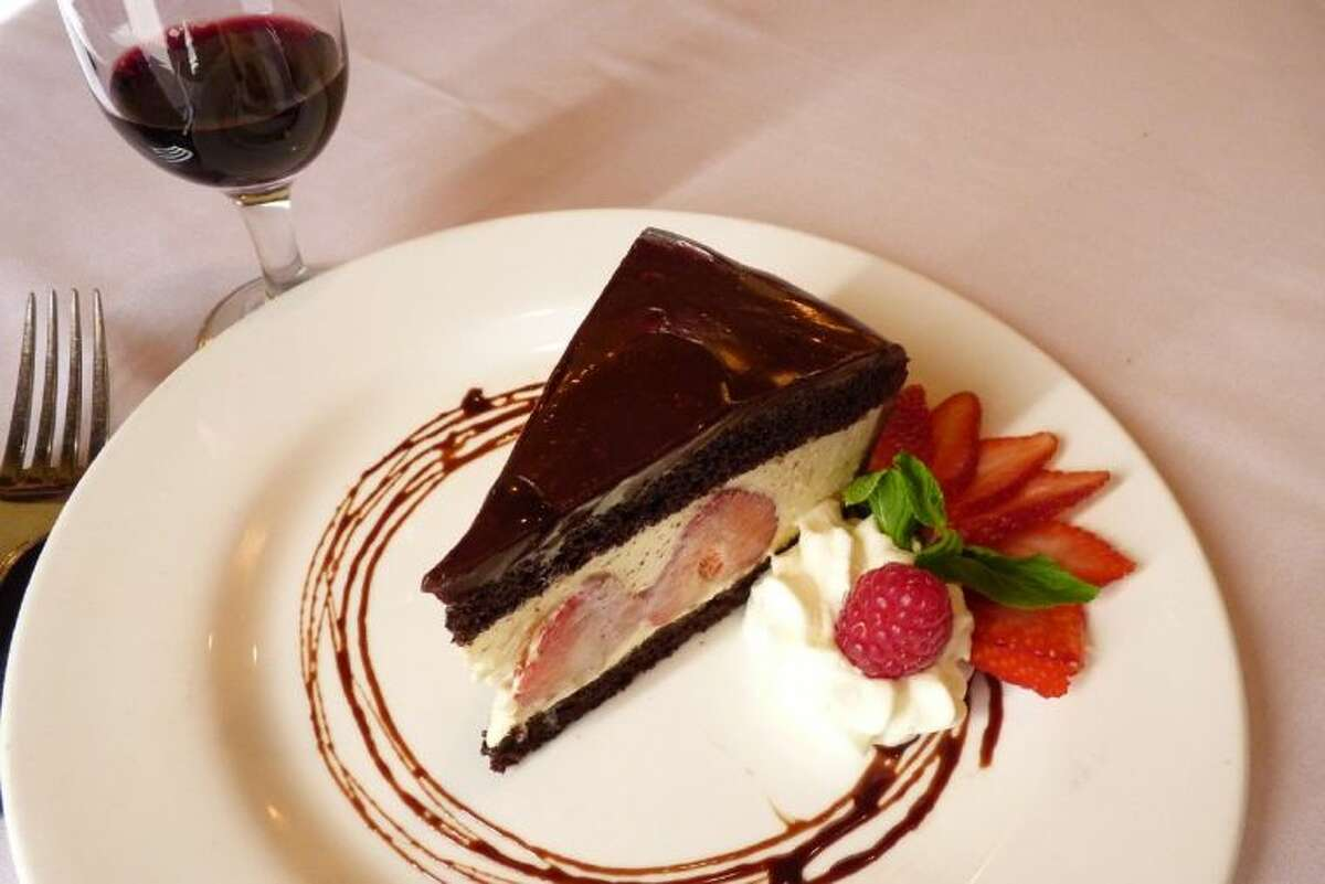 Strawberry and White Chocolate Mousse Cake with Baileys Chocolate Sauce.