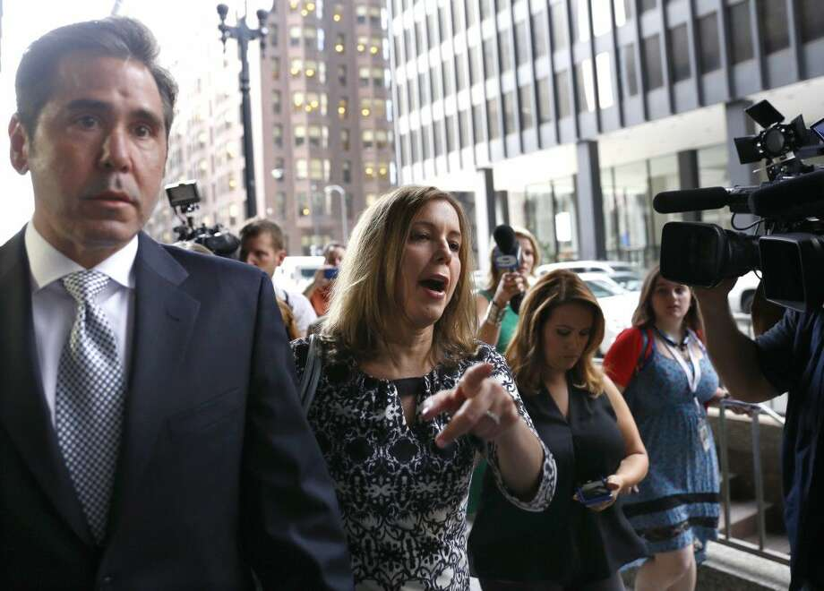 Patti Blagojevich, center, wife of former Illinois Gov. Rod Blagojevich arrives at the federal courthouse Tuesday in Chicago. A federal judge will decide whether to cut ex-Illinois Gov. Rod Blagojevich's 14-year prison sentence after an appeals court threw out some of his convictions related to his alleged attempt to sell or trade an appointment to President Barack Obama's old Senate seat.