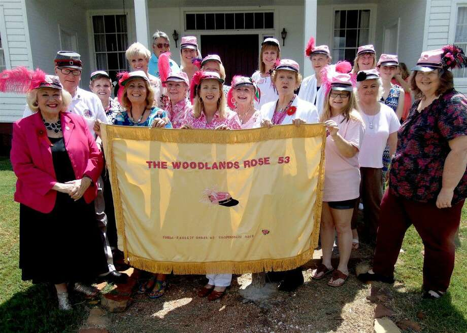 Pictured are members of the Woodlands Rose Chapter, Order of the Confederate Rose during their recent meeting held at Fernland Historical Park in Montgomery. The group, displaying their new chapter flag, created by Eva Rains, are standing in front of the Hulon House, which is an example of a Civil War-era wood frame plantation house. Photo: Submitted Photo