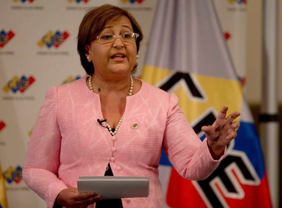 National Elections Council President Tibisay Lucena speaks during a televised nation wide speech, from her office in Caracas, Venezuela, Tuesday. Venezuelan elections officials have set an October date for a recall drive against President Nicolas Maduro.
